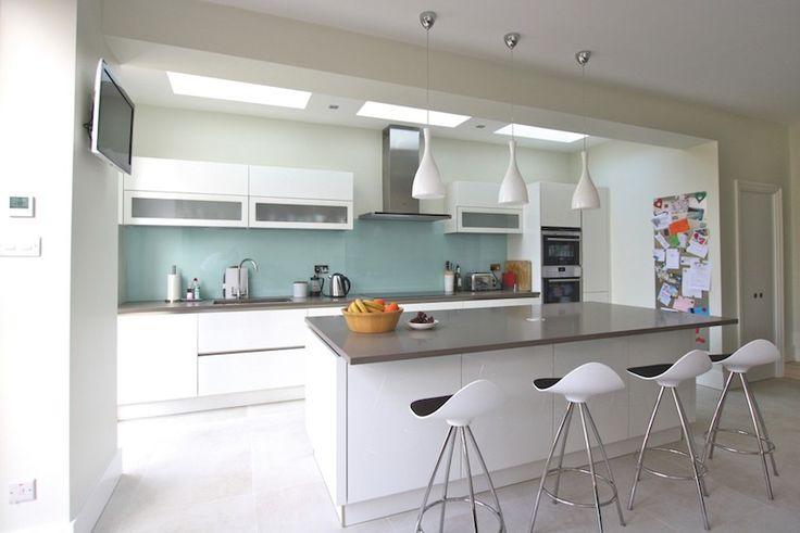 White Grey Handleless Kitchen - Gloss white kitchen island design - Discover more at www.lwk-home.com