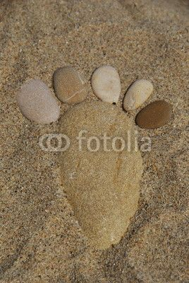 Foot stone on the sand