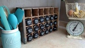 """""""I used an old Coke crate along with baby food jars to make a fun spice rack. I picked up some chalkboard spray paint at Walmart of all places, for a few bucks and painted the lids."""""""