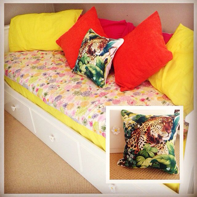 Ikea Hemnes Day Bed & quilt cover, Zara Home flower knobs and leopard cushion & BHS cushions and pillow cases...