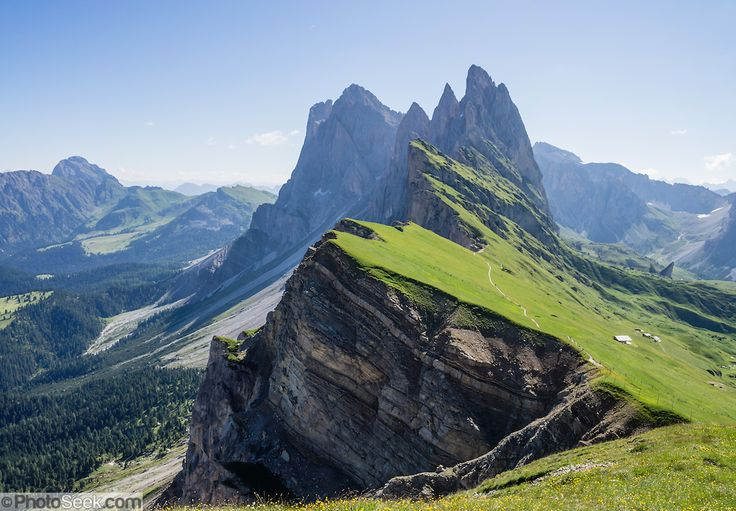 Sharp spires of the Geisler/Odle Group soar above green Alpe di Seceda, above St. Christina and Ortisei, in South Tyrol, the Dolomites, Italy, Europe. The beautiful ski resort of Selva di Val Gardena (German: Wolkenstein in Gröden; Ladin: Sëlva Gherdëine) makes a great hiking base in the Trentino-Alto Adige/Südtirol (South Tyrol) region of Italy. For our favorite hike in the Dolomiti, start from Selva with the first morning bus to Ortisei, take the Seceda lift, admire great views up at the…