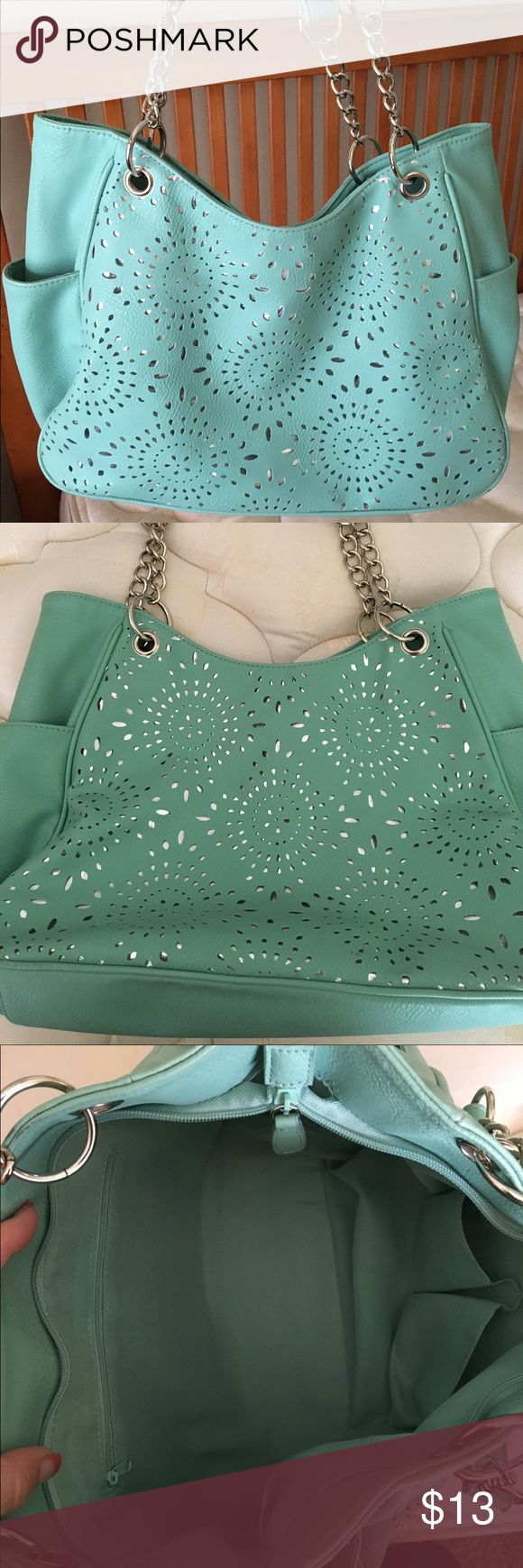 Super cute Seafoam Green Purse Super cute Seafoam Green Purse with Silver cut out accents.  Bought from Payless Shoes. Good condition. Size demensions are 13 x 11.  Very fun summer color. Payless Shoe Source Bags Shoulder Bags