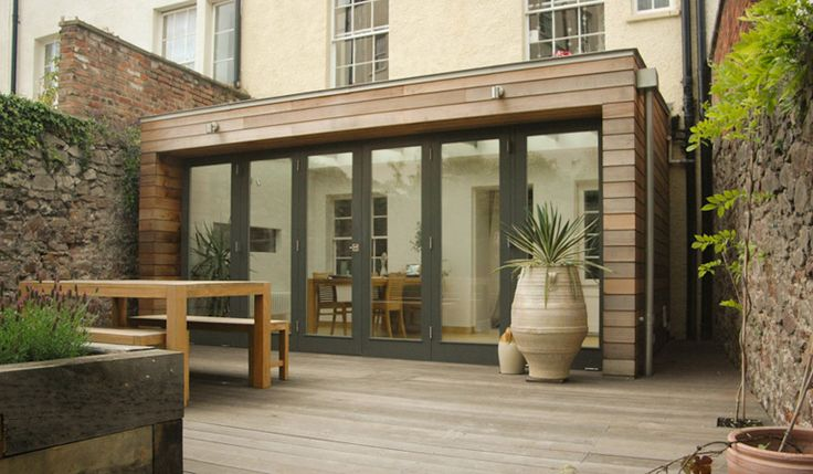 Nice combination of timber cladding and aluminium bi-folds