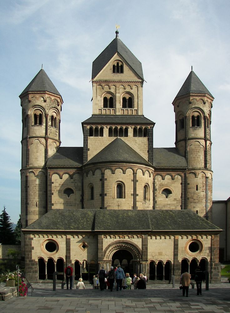 "The westwork of the Maria Laach Abbey, Germany, C12th, (porch 1225) is typical of Germany, a form that dates to Carolingian architecture with grouped towers of different plans and both ""candle-snuffer"" and Rhenish helm spires."