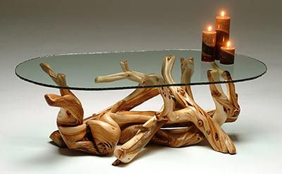 This artistic coffee table is handcrafted from natural wood branches, logs & glass for a unique organic style coffee table. Sustainable. Custom made sizes.
