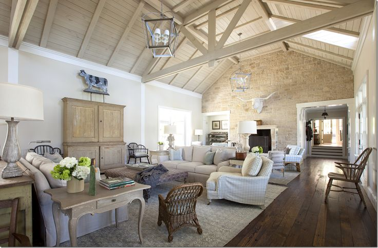 """Love it all, but the cow is the cherry on top in this new Texas """"farmhouse"""" style living room. Via Cote de Texas."""