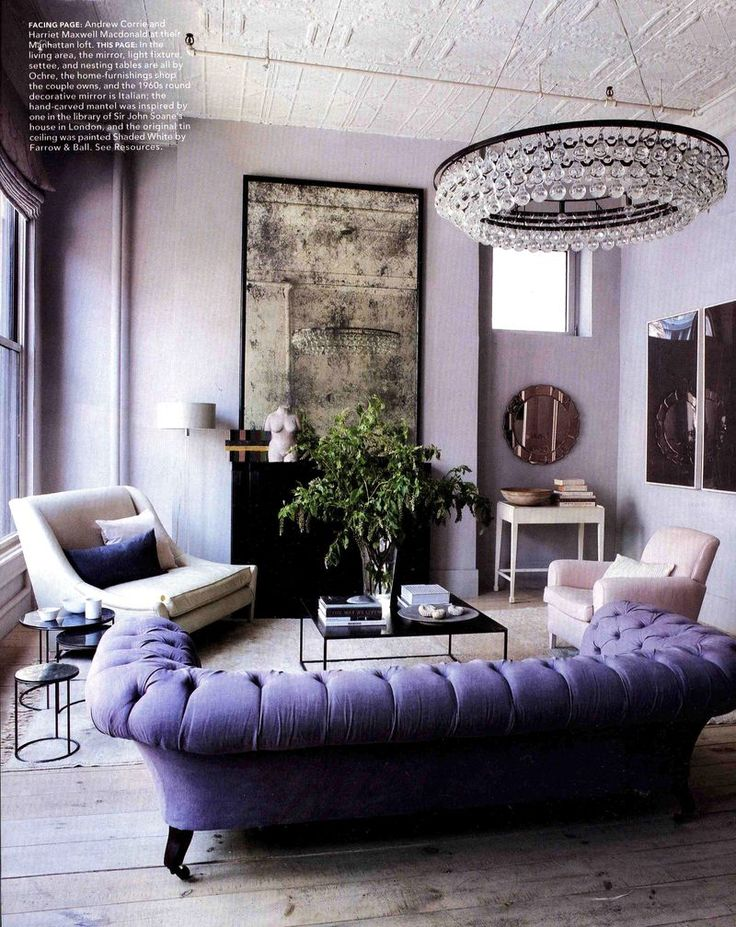 I may be wrong, but this chic lavender room reeks of the french Quarter in New Orleans. Love the chandelier...a purple Chesterfield!:
