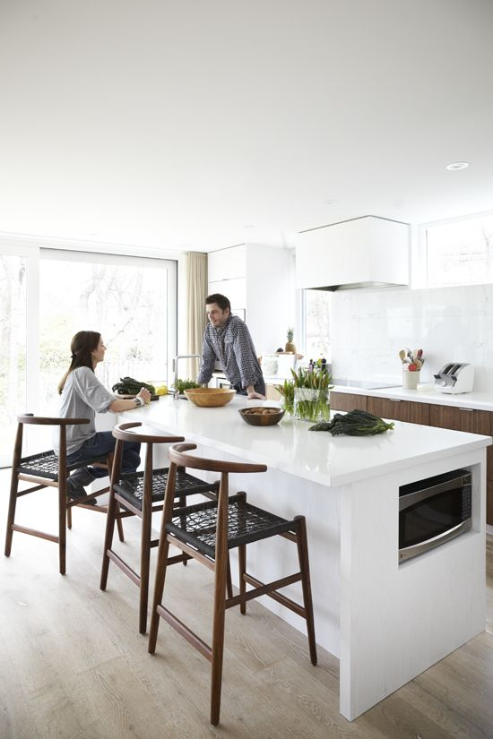 Modern kitchen; neutral, light & airy with hits of warmth through the dark wood cabinets and chairs