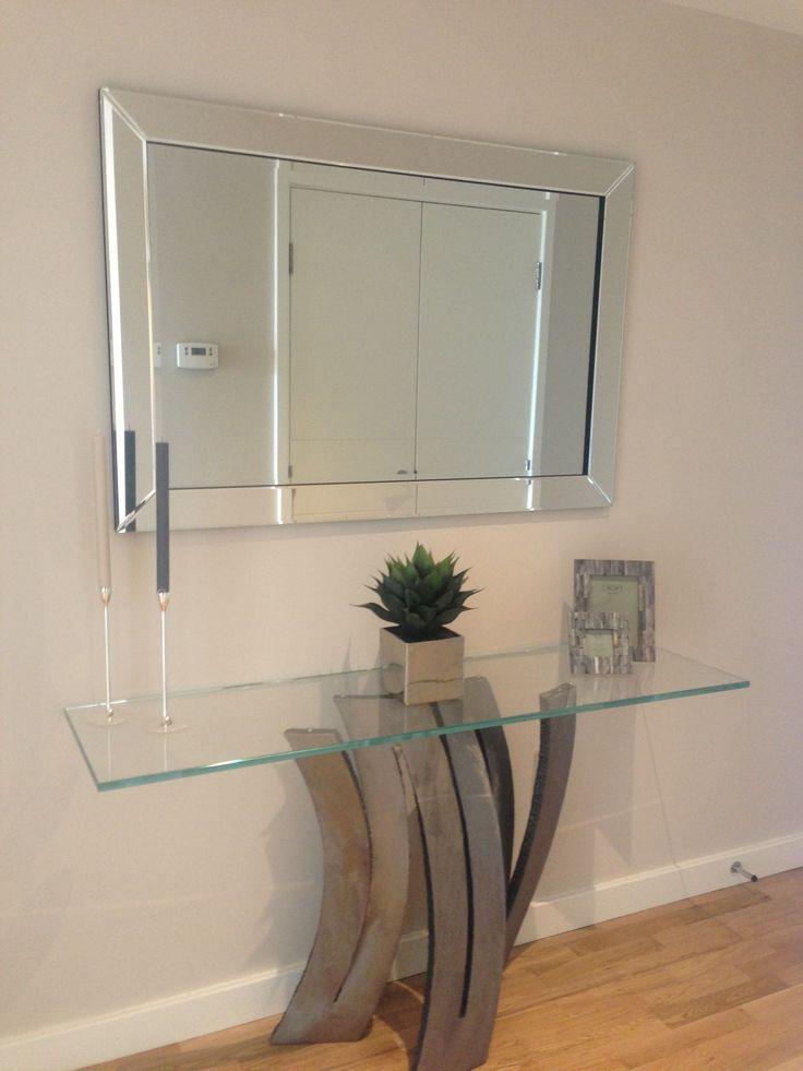 Simple Understated Mirror Featured Above Sculptured