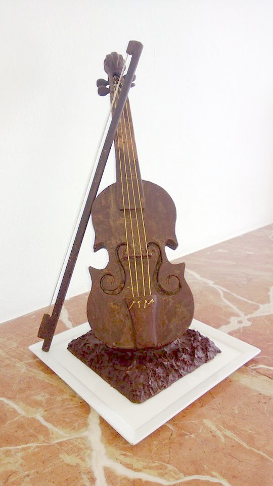 Chocolate carved violin by Chef Dzib at Cozumel Palace perfect for your destination wedding #pastry #chocolate #destinationwedding