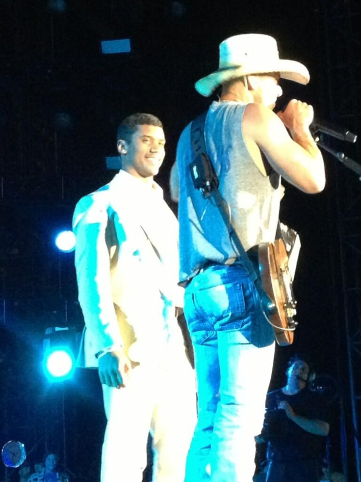 Russel Wilson on stage with Kenny Chesney