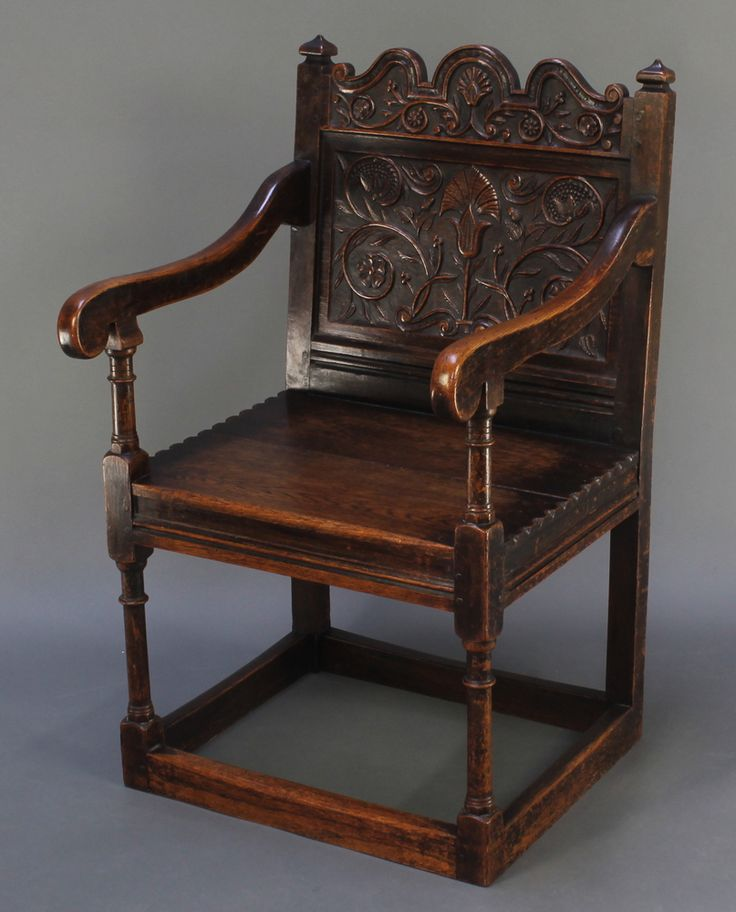 Lot 917, A Victorian oak open arm chair with carved panelled back and solid seat, raised on turned and block supports est £60-90