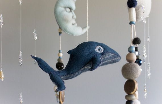 Soft Sculpture Eco-friendly Felt Baby Mobile Into the Blue  Invoke the sentiment of a carefree childhood with this traditional heirloom nautical mobile. Brimming with character, the components of this whimsical mobile have been designed to promote and inspire a sense of adventure. Working from my own original patterns, the hand cut and hand stitched elements of this mobile will ensure that each mobile is truly one of a kind.  This mobile is made to order. The mobile pictured has sold. I am…