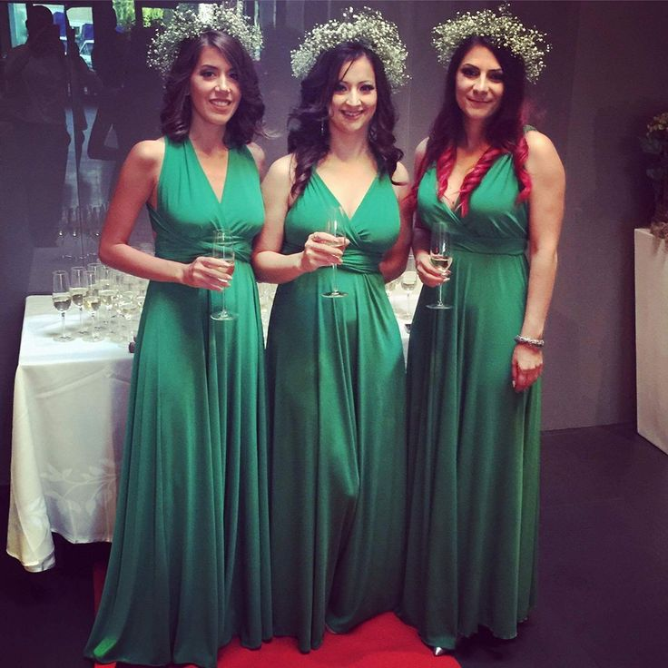 green infinity dresses for the bridesmaids; baby's breath flower crowns