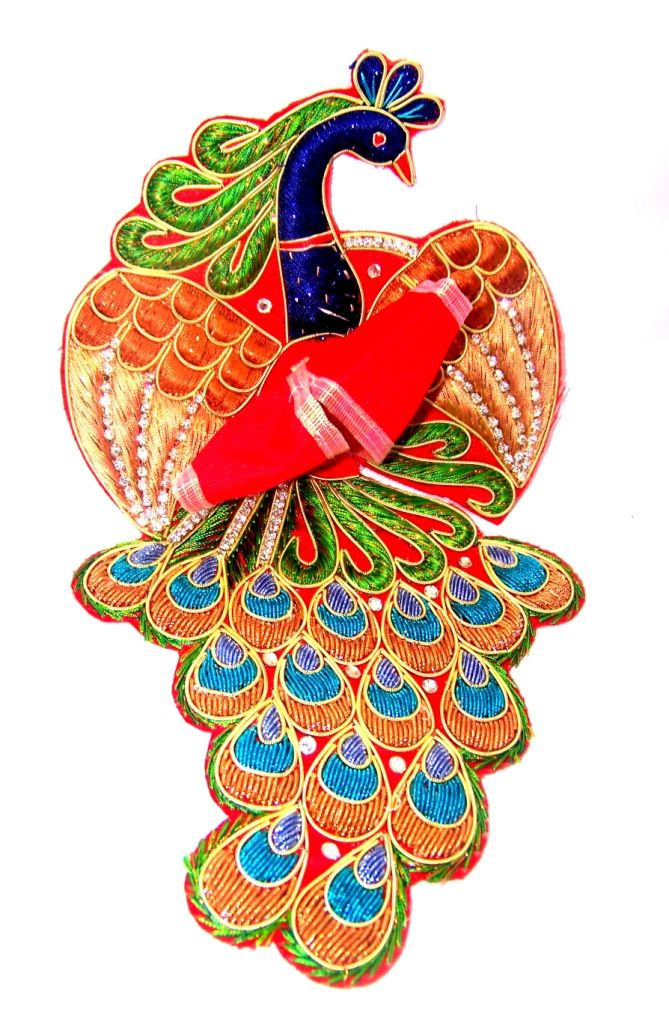 Rajadhiraj Zari Poshak is a uniquely designed Red & Blue Laddu Gopal dress with a divine peacock pattern. This designer dress is made by Silk with perfectly finished and durable decorative Zari & Stone work.  There are different color embroidery and other types of work on the poshak giving it a stunning appearance. Pl. visit http://www.divinekraft.com/POSHAK---DRESS/Rajadhiraj-Zari-Poshak-id-1780521.html