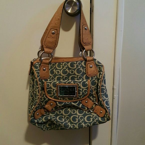 !!!SOLD!!! Guess denim and camel bag Authentic Guess denim and camel bag. So unique and so gorgeous! Brand new never used. No tags attached Guess Bags Totes