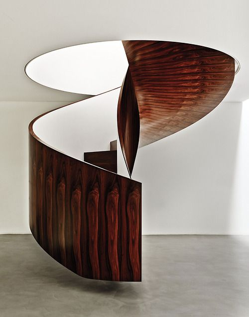 Weinfeld's Brazilian ironwood spiral floating staircase. Photography by Adrian Gaut