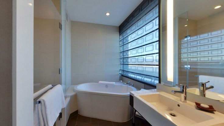 Bathroom And Soaking Tub In A One Bedroom Loft Suite At