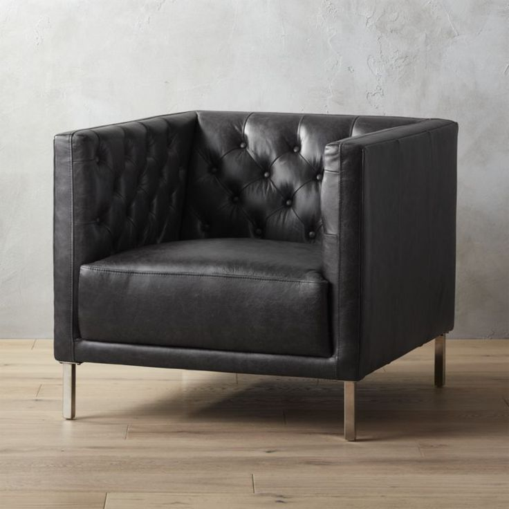 Shop savile leather chair.   We edged up the classic Chesterfield silhouette with buttery black leather and clean modern lines.  Out with the traditional curved arms and in with a minimal squared-off frame.
