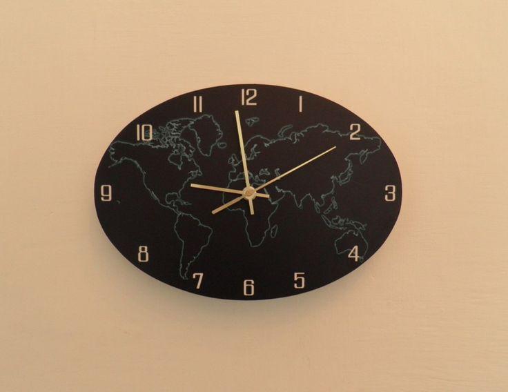 Világóra csendes óraszerkezettel. Earth wall clock with silent clockwork.