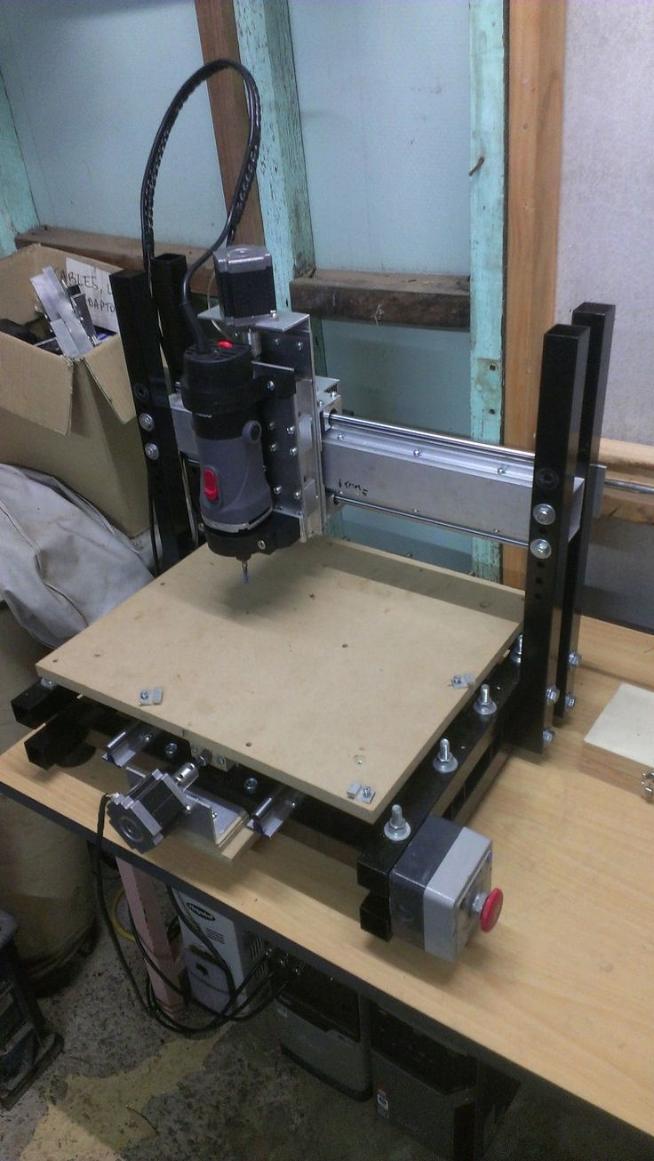 CNC Router by baskarz -- Here's my little desktop cnc i built a few years back. I was on a fairly tight budget so it had be cheap but also reasonably rigid as i wanted to machine aluminium. Frame is recycled 32mm square steel tubing with the gantry a piece of scrap rectangular alloy tube from the boatbuilders (the guys there are awesome, they let me scrounge through their alloy scrap bin for nix! always pickup nice slabs of alloy from 8mm thick up to 25mm thick and everywhere in between…