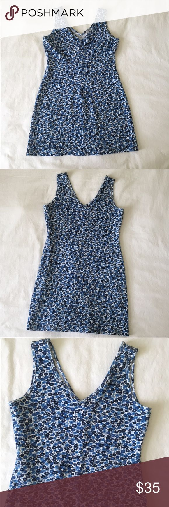 """90s Floral Mini Dress, Blue and White Vintage 90s Floral Mini Dress, Blue and White Small Floral Print, Waffle Material, Brand: M Basics, 56% Cotton, 42% Polyester, 2% Spandex, Material has Stretch, Tag Says Size Large, See Measurements for Sizing, Fits more like Medium or Small, Listing this as Size Medium, Great Condition, V-Neck in Front and Back, Length 31"""" Underarm to Underarm 34"""" Waist 33"""" Hips 40"""" Vintage Dresses Mini"""