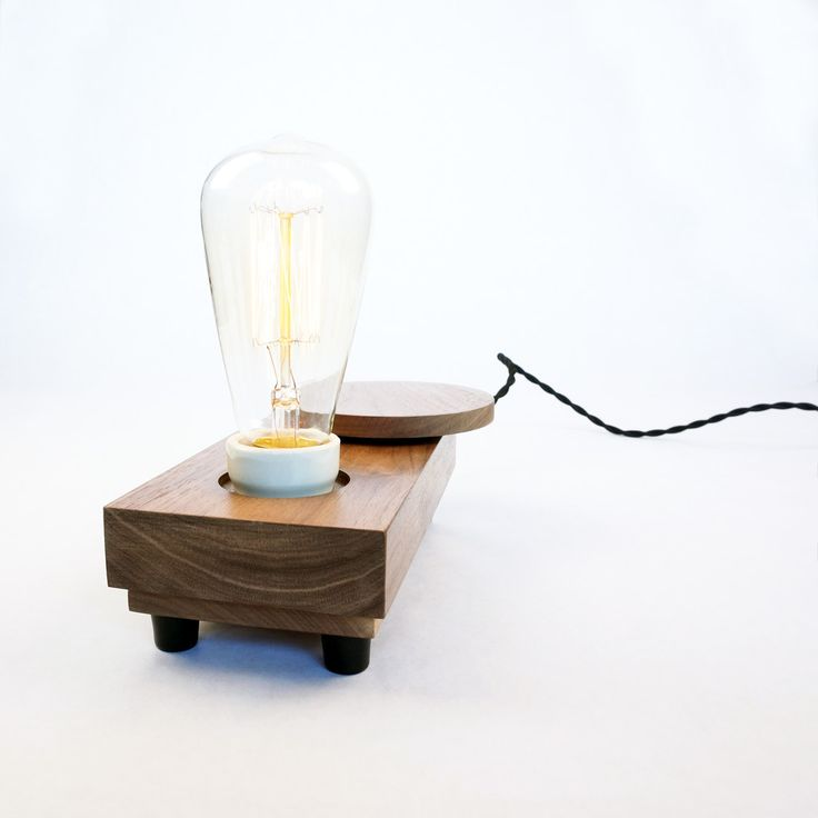 Lamp 'Disc rev.01' |  Unique table lamp handcrafted in small series with 'sealed' Walnut wood. The horizontal disc operates the dimmer and switches the lamp on/off.  #industrialdesign #design #deco #light #lighting #lamp #tablelamp #edison #woodwork #wood #handmade #handcrafted #unique #exclusive #Zzz #filament #hip #authentic #woodworking #minimalist #minimalism #1900s #moderndesign #productdesign #walnut