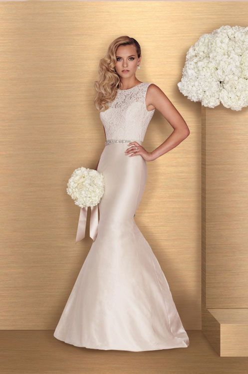 An ivory satin and lace fit & flare bridal gown with bateau neckline by Paloma Blanca - Style 4664