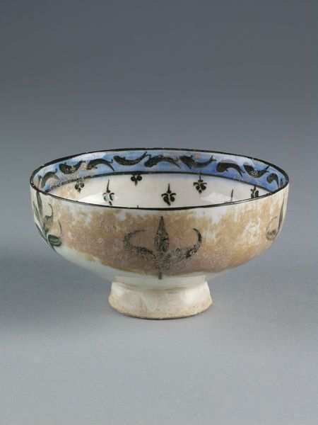 Bowl of fritware decorated in black and cobalt blue under a transparent glaze, found at Jurjan. Iran, probably Kashan, 1180-1220.