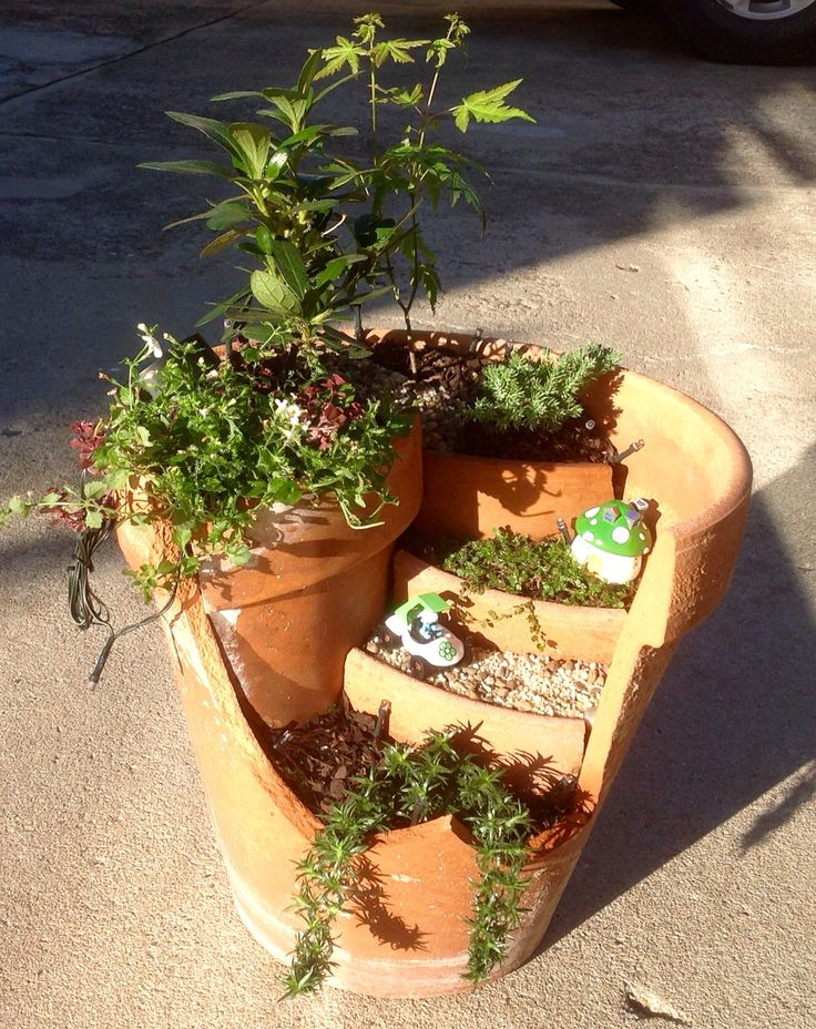 Broken Pot Smurf garden with solar fairy lights