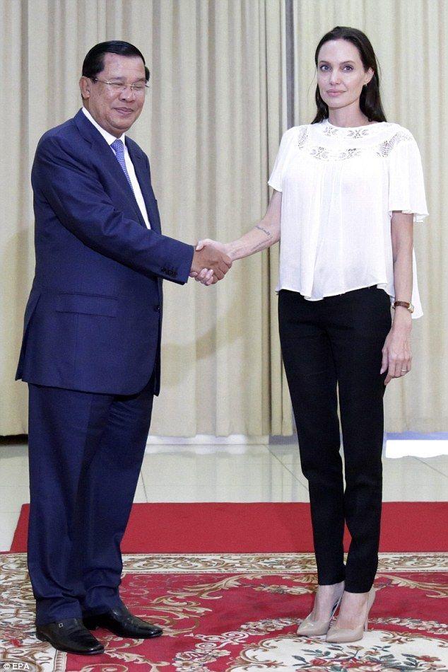 Handshake: Hun Sen and Angelina enjoyed a brief handshake before they began discussing her...