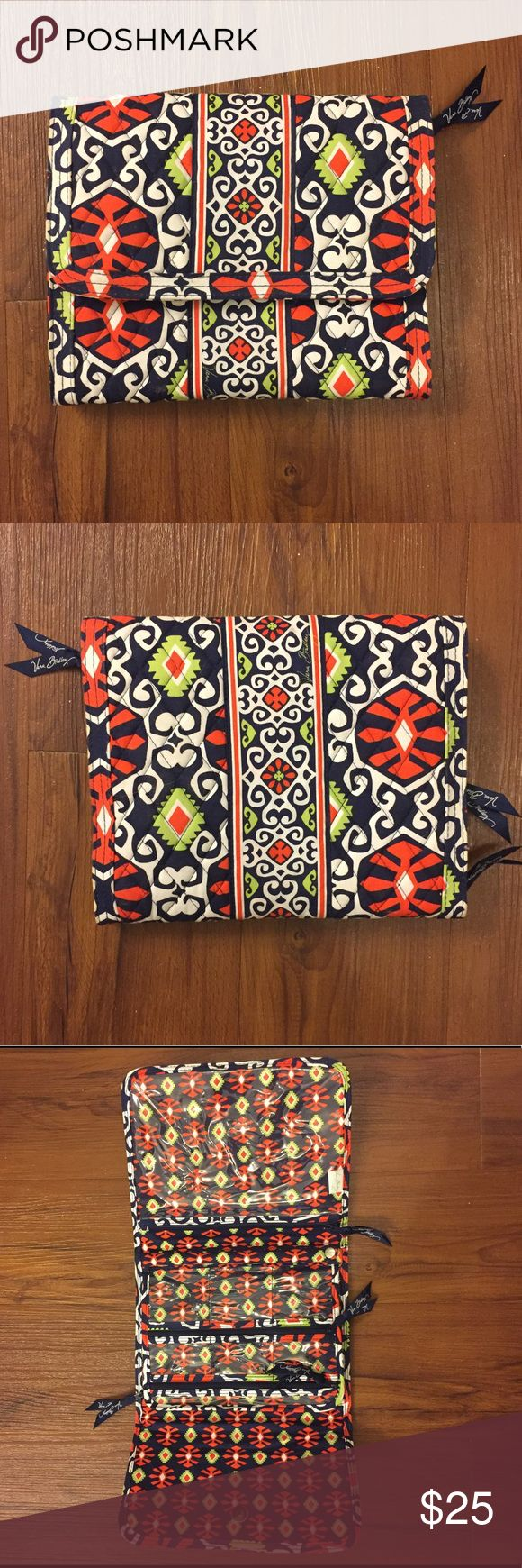 Vera Bradley Travel Jewelry Organizer Vera Bradley travel tri-fold jewelry organizer in Sun Valley Print. Quilted fabric on outside and 9 zippered clear pockets of various sizes on inside, also has a ring holder snap sleeve and snap closure. Great condition! Vera Bradley Bags Travel Bags