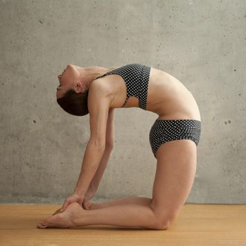 Beautiful Woman doing Camel Pose