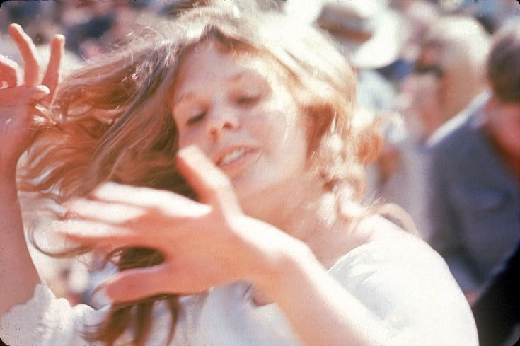 A woman dances in the sun at the KFRC Fantasy Fair and Magic Mountain Music Festival, held at the summit of Mount Tamalpais near San Francisco in early June 1967.