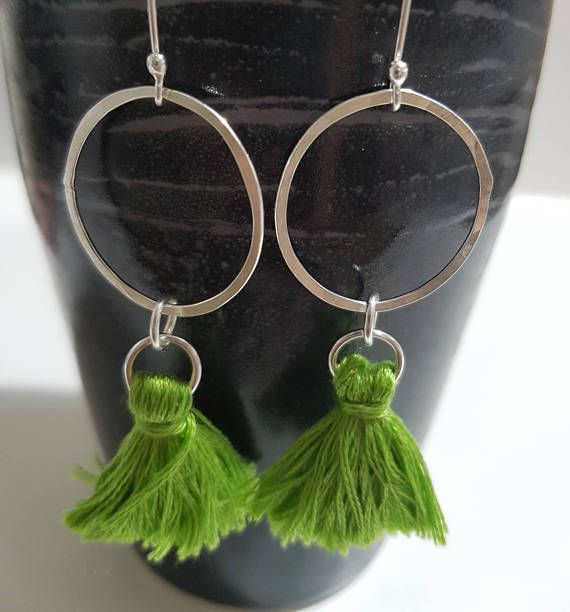 Check out this item in my Etsy shop https://www.etsy.com/listing/532342433/tassel-dangle-silver-circle-earrings