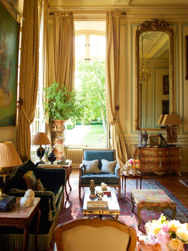 Interior designer Timothy Corrigan transformed a neoclassical château in France's Loire Valley into his own home away from home. A Régence commode and Louis XIV armchair grace the master bedroom.