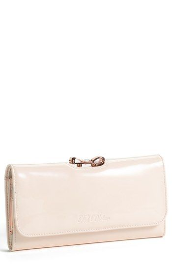 "Ted Baker London 'Crystal Bow Bobble' Matinee Wallet in Nude Pink $130 | Nordstrom / 7 ½""W x 4""H x 1""D / Interior currency and coin pockets; 11 card slots; ID window"