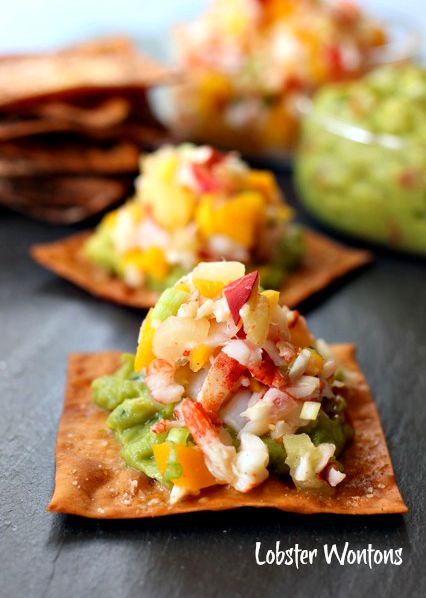 Bite-sized lobster tacos! Lobster salad with mango and pineapple served on top of a crispy baked wonton!