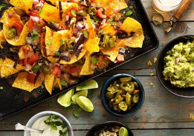 Nachos, piled with beans, cheese, lime and guac! Shot by Jim Norton