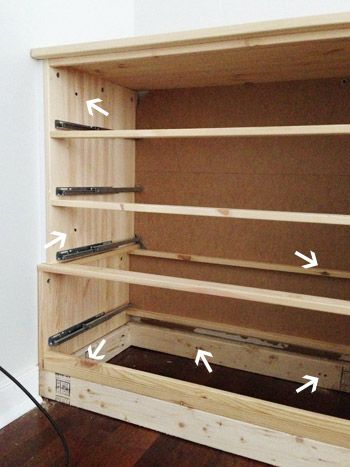 How to make free standing dressers look built in - cut baseboard, use trim to cover any gaps on the side, add a base so baseboard can wrap around the bottom yet not block the drawers from opening, secure dresser to wall.