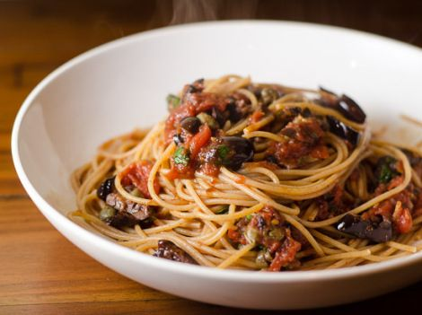 "Spaghetti alla Puttanesca, literally means ""whore spaghetti"" in Italian. It is a warm, spicy and fragrant pasta dish. The recipe consists of typical local ingredients, such as fresh tomatoes, olives, red peppers, garlic, and capers. Over the pasta fresh Italian parsley is sprinkled"