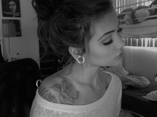 Rose tattoo ... Stretched ears and sparkely tunnells and big eyelashes :))