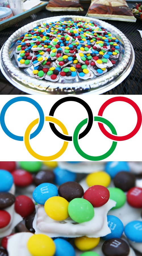 Easy Olympic treat!  Dip square pretzels in Almond Bark. Add m & m's to look like Olympic rings. Great food for an Olympic party!