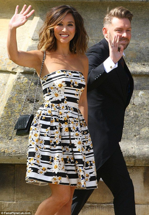 Celebratory mood: As she walked into the venue, she waved at the score of wellwishers who had gathered