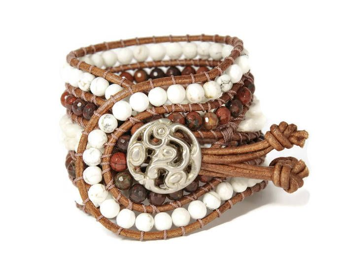 A bohemian trend bracelet !!! Semi precious stones of howlite, jasper red are framed by brown leather woven together with beige cotton cord. This eye catching design also features a silver metal, closure.This bohemian style bracelet upgrades your casual or evening look.