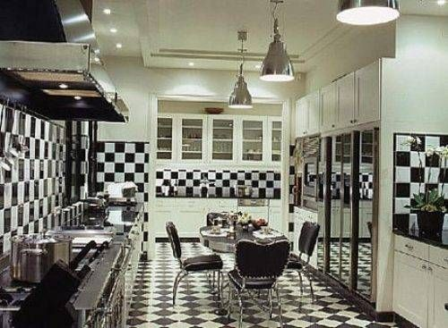 Black And White Checkerboard Tile Is Used Two Ways In The Parisian Kitchen  Of The Late Designer Alberto Pinto.
