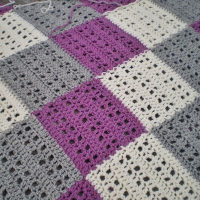 The Fairy Shoemaker: The Love Blanket - Free crochet pattern. This is worked as a strip which further squares are joined to as you go.