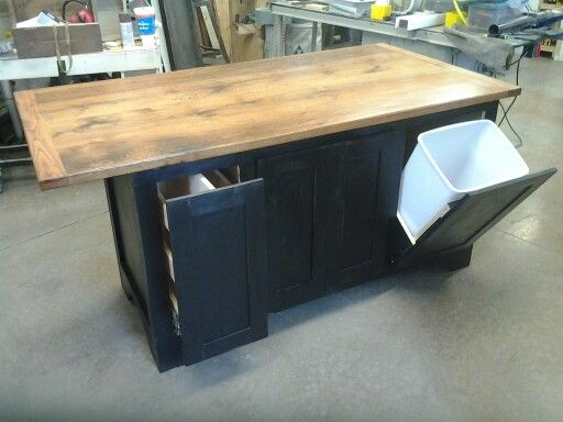 Kitchen island with pull out garbage and pan drawer seats for Kitchen island with drawers and seating