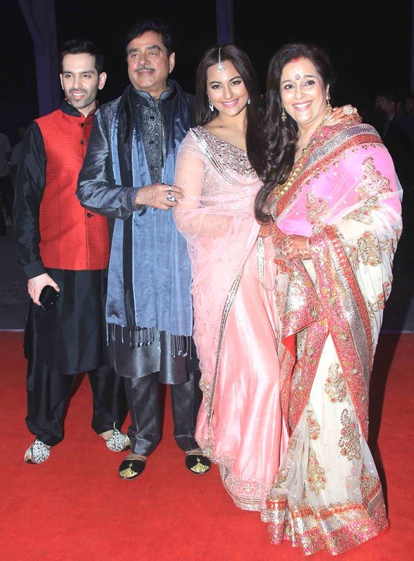 Luv Sinha with father Shatrughan Sinha, sister Sonakshi Sinha and mother Poonam Sinha pose for the shutterbugs at Kush Sinha's wedding reception.