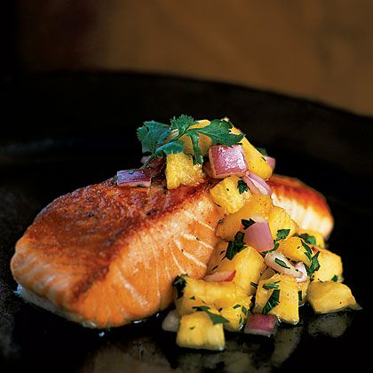 Perfect for a summer night, this tropical salmon provides omega-3 fatty acids. Add fiber, which aids in digestion, with half a cup of whole-grain rice. Try this pan-grilled salmon with pineapple salsa. | Health.com